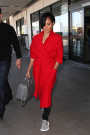Jada Pinkett Smith matched her shoes with a gray leather bowler bag.