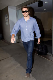 Actor Jake Gyllenhaal wore a pair of Walker relaxed straight leg jeans in boone while arriving at LAX International Airport.