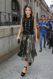 Jamie Chung teetered on a pair of black Giuseppe Zanotti platform sandals while headed to the New York Fashion Week shows.