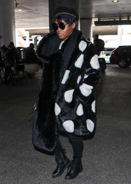Janelle Monae was impossible to miss at LAX wearing this polka-dot faux-fur coat by Kate Spade.