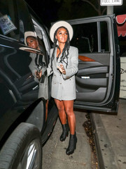 Janelle Monae styled her dress with a pair of textured black ankle boots by Christian Louboutin.