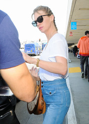 January Jones hid her eyes behind a pair of cateye sunnies as she arrived on a flight at LAX.