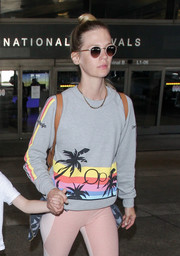 January Jones topped off her travel outfit with a pair of Garrett Leight sunglasses.
