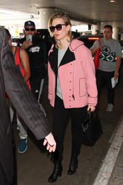 January Jones hit LAX wearing a stylish pink and black biker jacket by Blumarine.