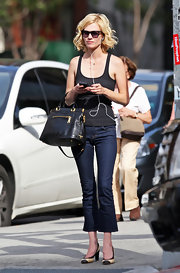 "'Mad Men' actress January Jones was seen in Soho wearing a pair of J Brand ""Gigi"" mid-rise cropped flares in Pure"