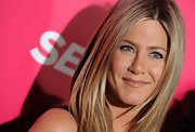"Jennifer Aniston showed off her signature ""bronde"" locks at the launch of Mandy Ingber's new yoga book."