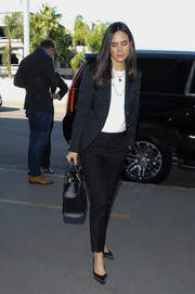 Jennifer Connelly completed her travel outfit with basic black slacks.