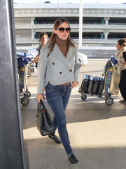 Jennifer Garner bundled up in a cropped gray pea coat by Khaite layered over a brown turtleneck for a flight out of LAX.
