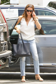 Jennifer Garner was casual yet stylish in a sleeveless white top with a contrast V neckline while running errands in LA.