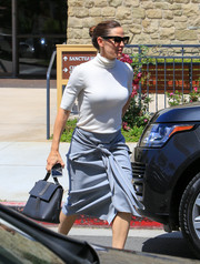 Jennifer Garner headed out in LA carrying a black single-strap tote by Brunello Cucinelli.