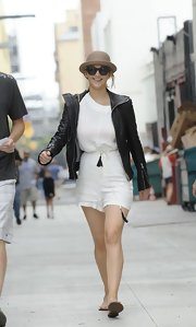 Jennifer Lawrence paired her white summery romper with this hooded black leather jacket.
