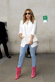 Jennifer Lopez showed off her love of the color white when she sported this white blazer over a classic white button down.