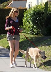 Jennifer Westfeldt took her dog for a walk wearing cool cargo shorts and a scoopneck sweater.