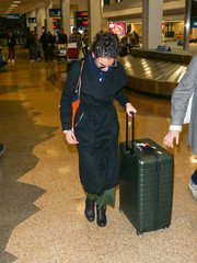 Jenny Slate was spotted at the Salt Lake City International Airport pulling along a large green suitcase.