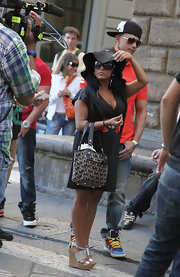 "Nicole ""Snookie"" Polizzi paired her black day dress with a monogrammed tan and black Michael Kors tote."
