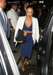 Jessica Alba finished off her dress with a sleek white blazer, also by Narciso Rodriguez.