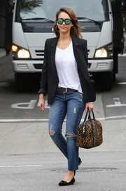 Jessica Alba layered a black blazer over her T-shirt for a smarter finish.