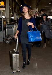 Jessica Alba made her way through LAX pulling along a Rimowa titanium rollerboard.