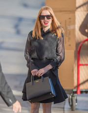 Jessica Chastain headed to 'Kimmel' toting a chic Prada bag.