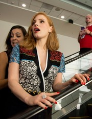 Jessica Chastain paired red nail polish with a colorful lace dress for her visit to Comic-Con.