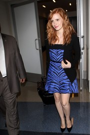 Jessica Chastain cut a chic figure at LAX in a blue tiger-print mini dress by Ungaro.