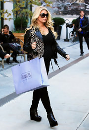 Jessica Simpson was out shopping in an animal-print jacket paired with black leather wedge boots.