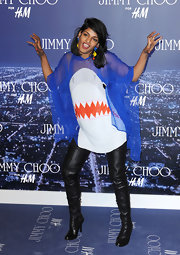 M.I.A. is never one to shy away from a truly bizarre fashion statement. At the launch of Jimmy Choo for H&M, the artist wore a right pair of dangling fish earrings—which appear to be in danger of being swallowed by her shark top!