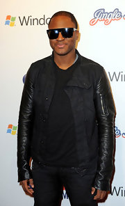 Taio dons a multi fabricated jacket with leather sleeves.
