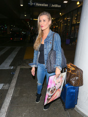 For her travel bag, Joanna Krupa chose a luxe-looking blue satin rollerboard.