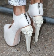 Jodie Marsh made skulls look good when she sported these white platform pumps with a carved skull heel.