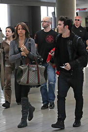 Danielle looked pulled together as she strolled through LAX in gray leather boots.