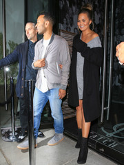 Chrissy Teigen layered a long black cardigan by Theperfext over a gray mini dress for a dinner out with the hubby.