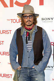Johnny wears a denim button down shirt under a pin stripe dress with this eclectic outfit.