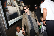 Angelina wore a classic trench coat while making a trip with her kids to the airport.