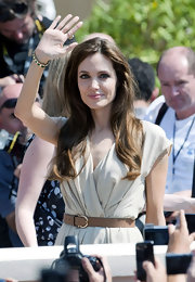 While in Cannes, Angelina Jolie added a tan leather belt with simple gold buckle to her super sweet day dress.