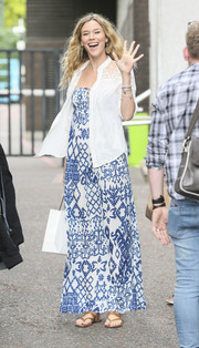 Joss Stone teamed her dress with a white lace-panel button-down shirt.