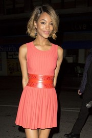 Jourdan Dunn accentuated her tiny waist with an oversized red-orange leather belt.