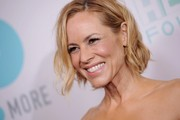 Maria Bello wore her hair in a short wavy style at the JoyROCKS NO MORE PSA launch.