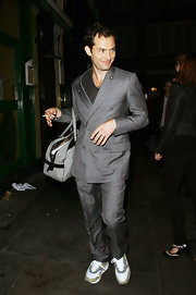 Fresh after his performance, Jude hits the street in a grey double breasted suit. His look is casual , but still gets the point across with his grey and gold running shoes.