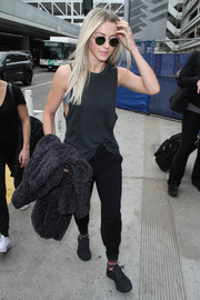 Julianne Hough looked ready for a workout in a black tank top while catching a flight at LAX.