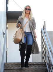 Julianne Hough was spotted outside a salon wearing a taupe American Apparel duster coat over a white blouse and jeans.