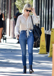 Julianne Hough completed her outfit with a pair of studded ankle boots.