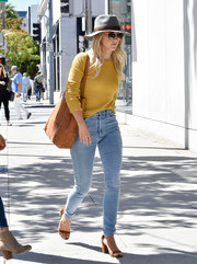 Julianne Hough styled her outfit with a pair of chunky-heeled brown sandals.