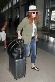 For her travel bag, Julianne Moore chose a stylish black leather duffle.