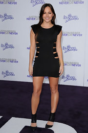 Briana got racy in a little black dress with cut outs at the premiere of 'Justin Bieber: Never Say Never.'