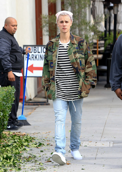 Justin Bieber teamed his jacket with distressed jeans by Saint Laurent.