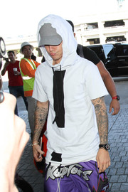 Justin Bieber accessorized with a black leather-band quartz watch for his flight out of LAX.