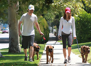 A bright red baseball cap completes Jessica's dog-walking outfit.