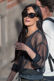Kacey Musgraves headed to 'Kimmel' wearing a pair of chic cateye sunnies.