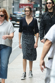 Kaia Gerber layered a black cardigan over a print dress for a casual day out in New York City.